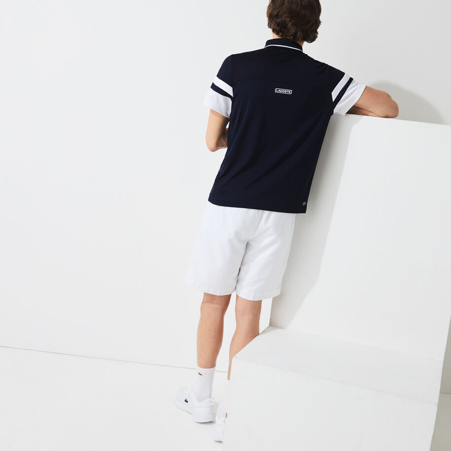 قميص بولو للتنس من البيكيه المسامي للرجال مع أكمام مقلمة مجموعة Lacoste SPORT