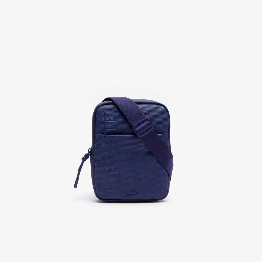 حقيبة صغيرة مسطحة بسحاب للرجال مزدانة بشعار العلامة التجارية من مجموعة L.12.12