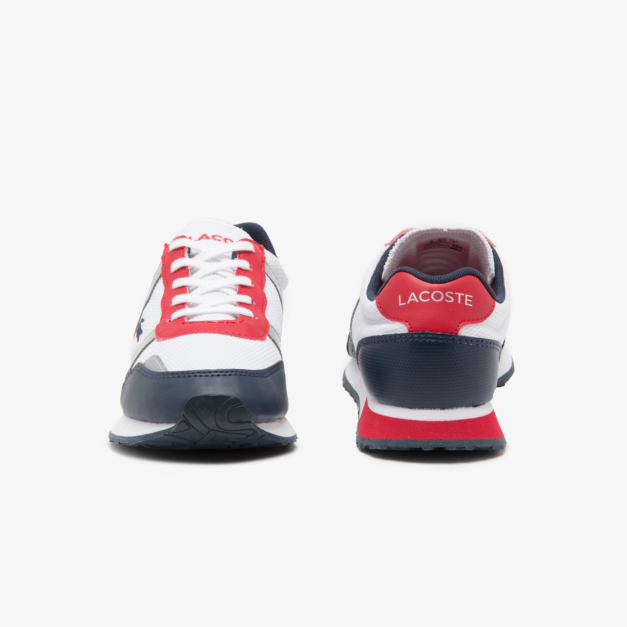 حذاء رياضي للشباب بأربطة من القماش ومواد صناعية